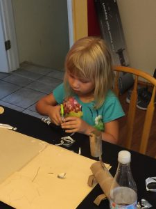 Trying to make her own animal.